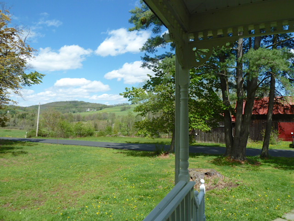 front porch to barn and view